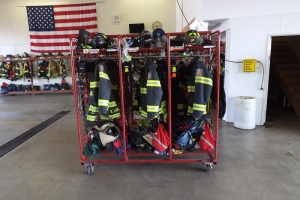Cortland Fire Department uniforms on a cart